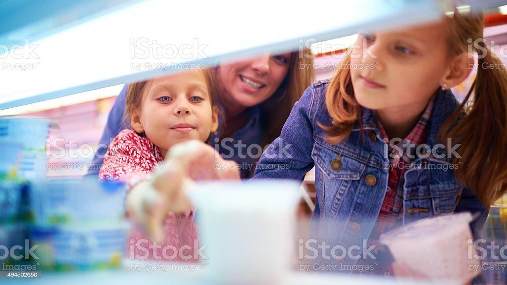 Taking yogurt in supermarket stock photo