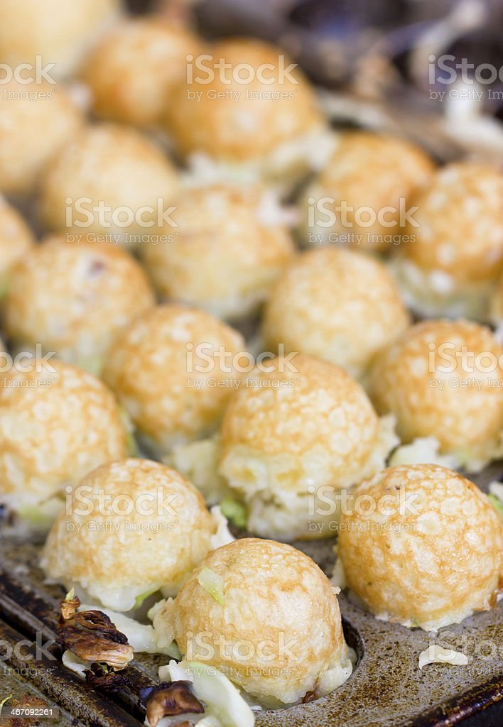 Takoyaki ball the Japanese sweetmeat at food market. stock photo