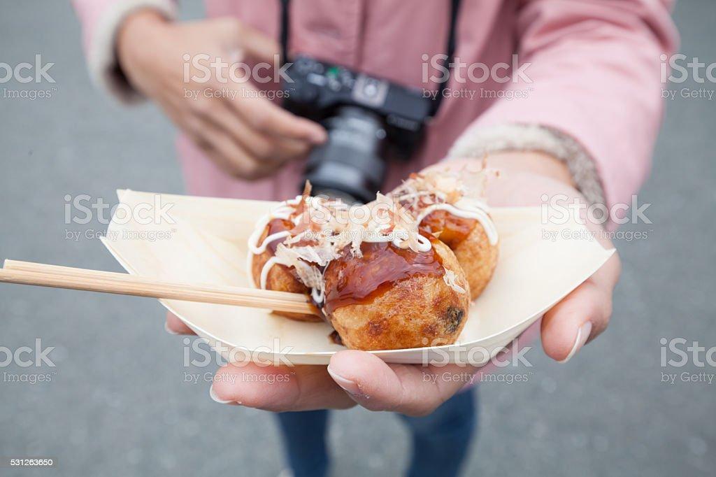 Takoyaki ,japanese food close up on hand stock photo