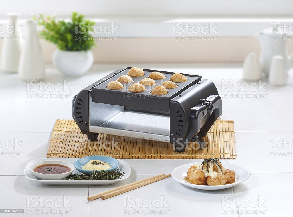Takoyaki japanese food making machine royalty-free stock photo
