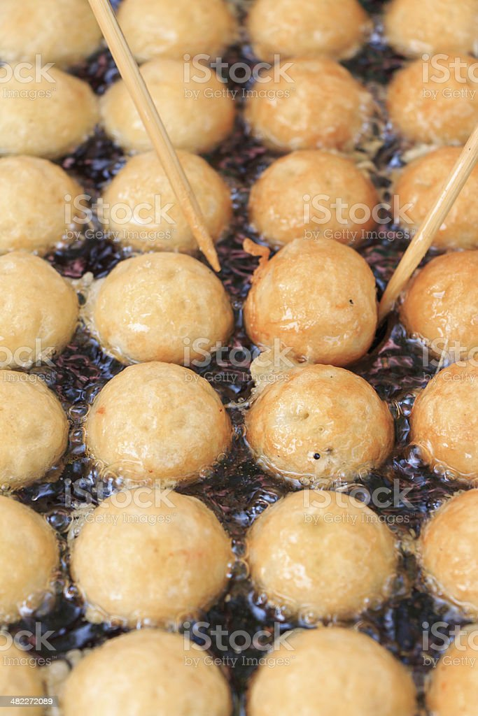 takoyaki making stock photo