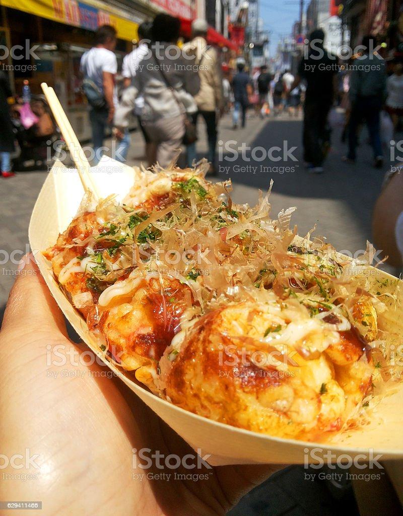 Takoyaki, octopus balls in paper boat plate stock photo