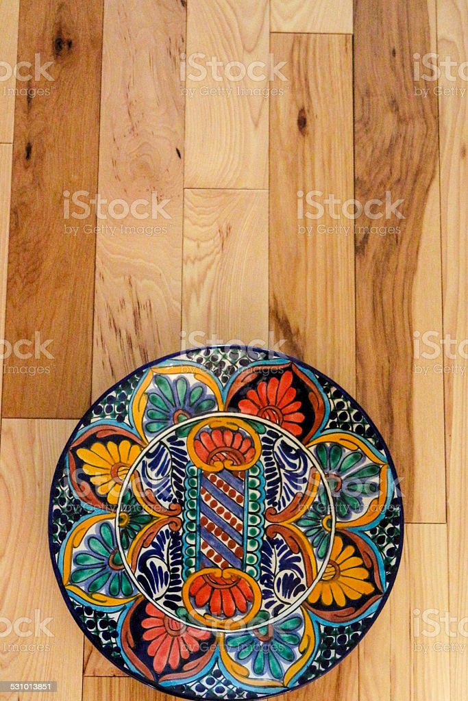 Talavera plate on hickory with vertical composition stock photo