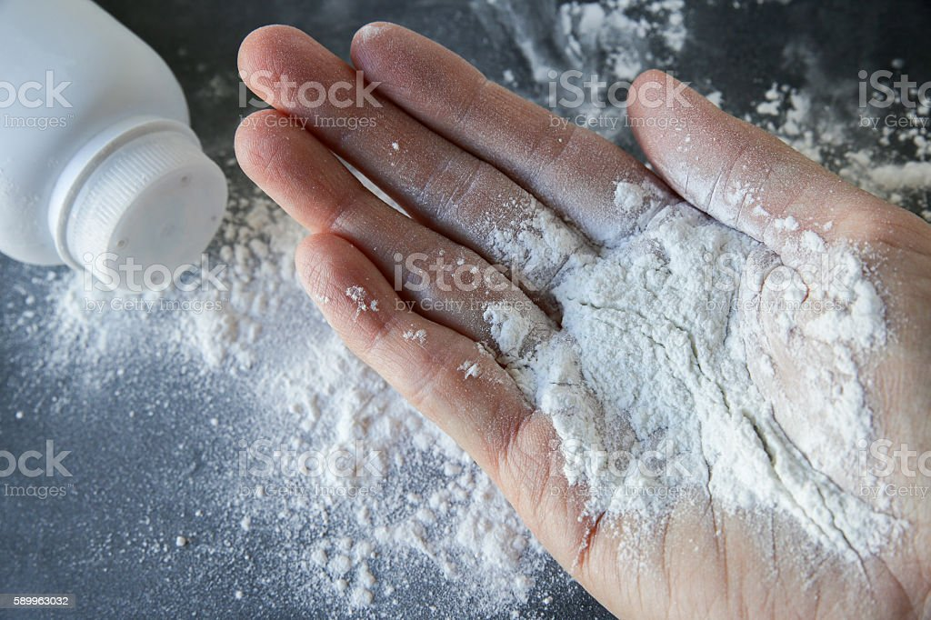 Talcum powder on hands stock photo