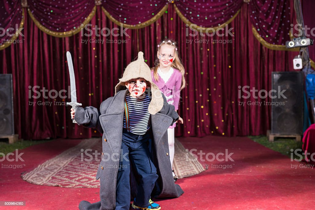Talented boy playing the role of a brave warrior stock photo