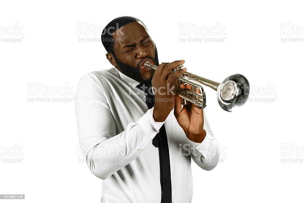 Talented man plays trumpet. stock photo