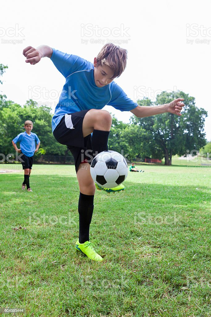 Talented soccer player performs tricks with the ball stock photo
