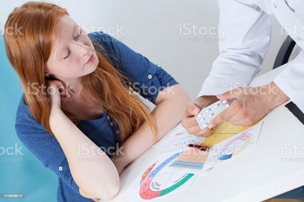 Talking about contraception with gynecologist stock photo
