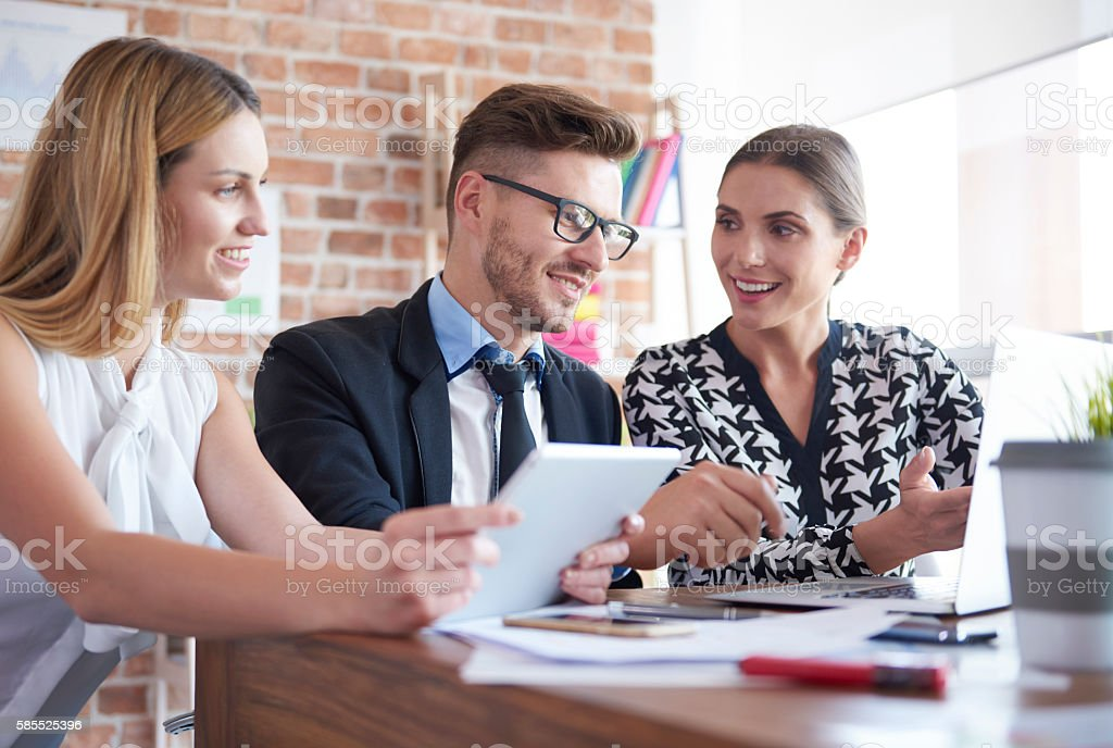 Talking about documents in the office stock photo