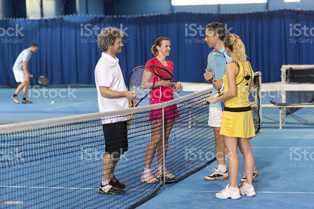 Talking After Mixed Doubles Match stock photo