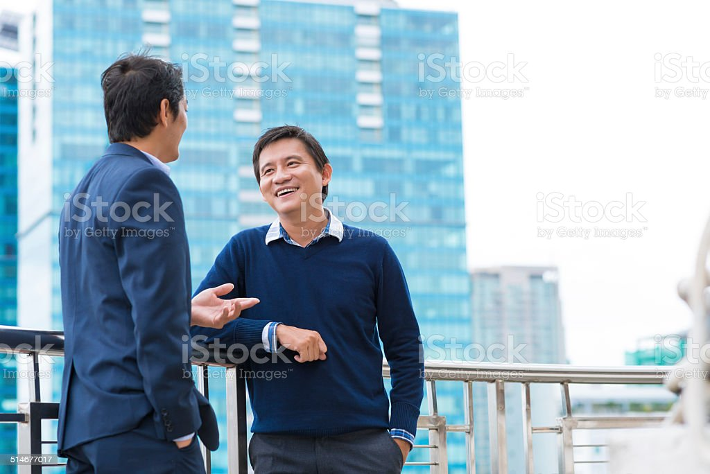 Talking and smiling stock photo