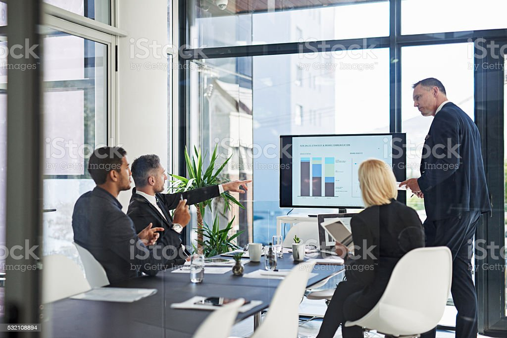 Talking business in the boardroom stock photo