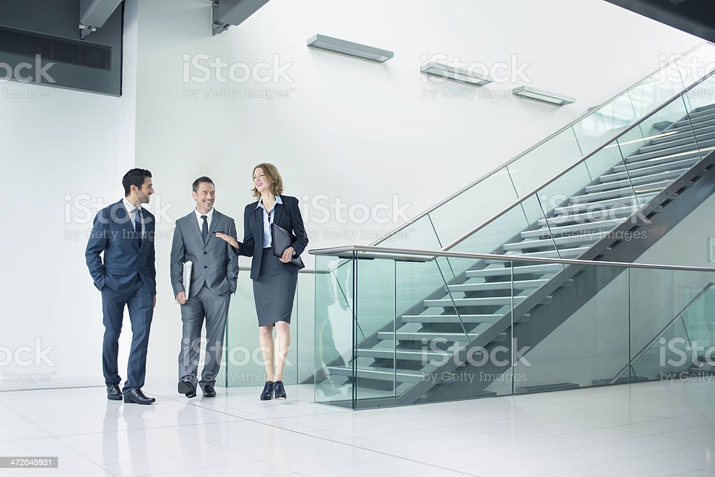 Talking business in the staircase royalty-free stock photo