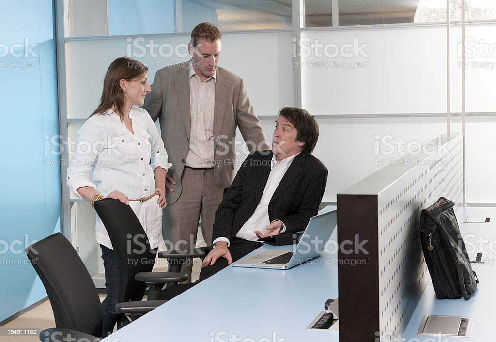 talking business people in office stock photo