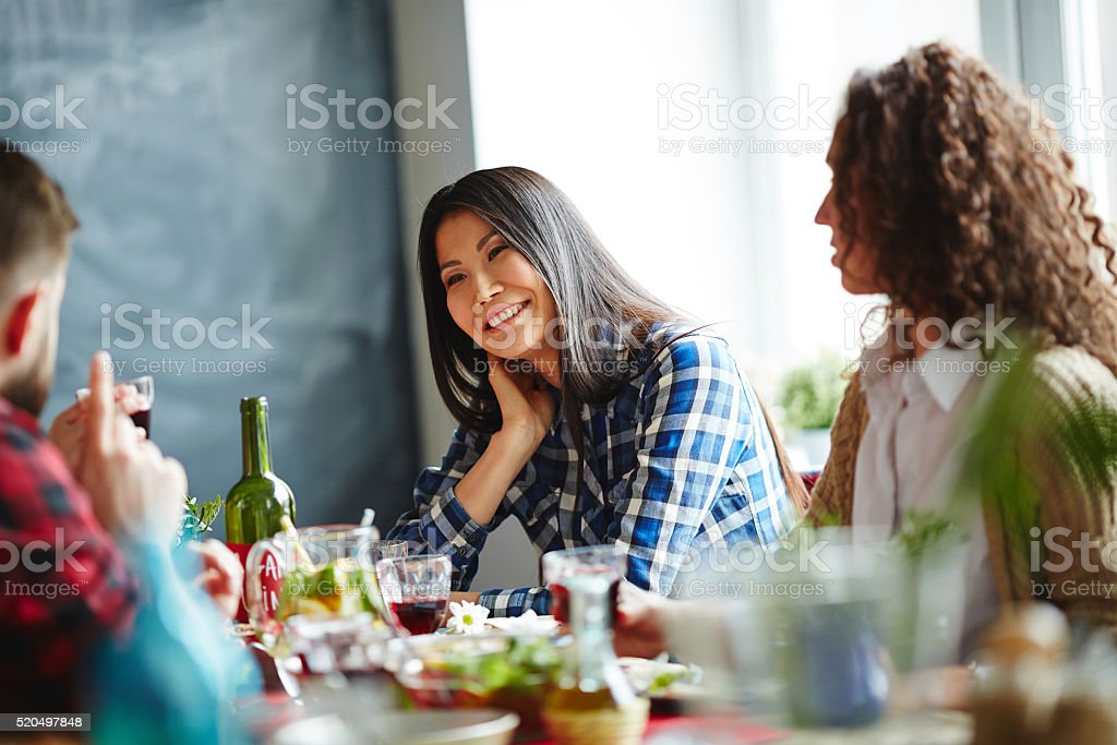 Talking by dinner stock photo