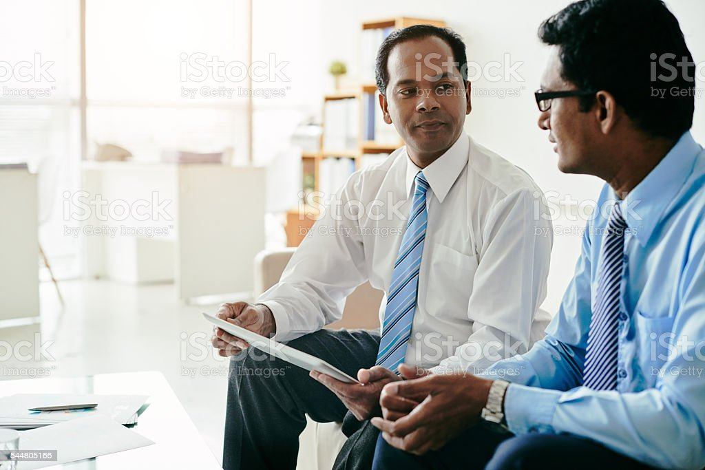 Talking colleagues stock photo