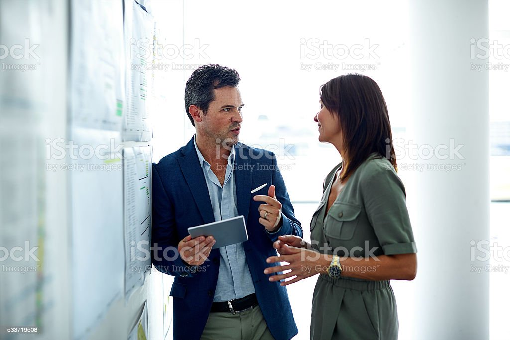 Talking figures on the way to the boardroom stock photo
