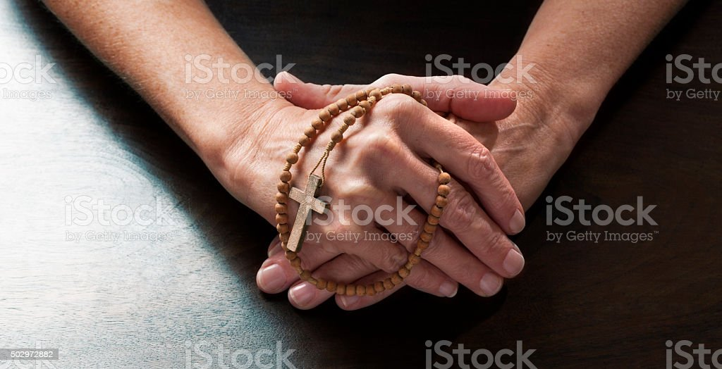 talking hands concept for female hands and Christian cross stock photo