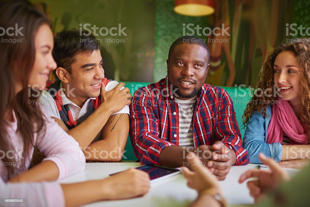 Talking in cafe stock photo