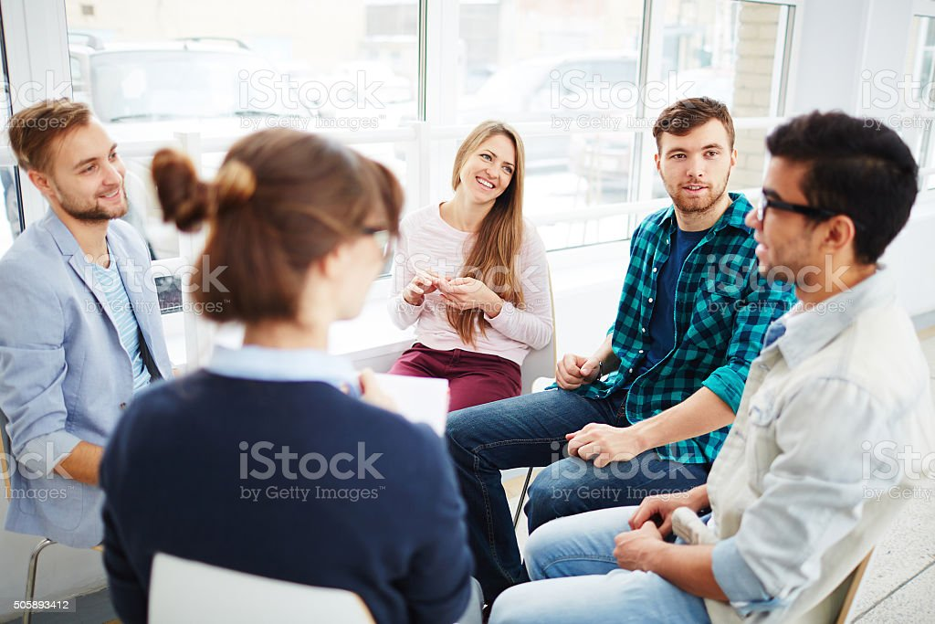 Talking in group stock photo