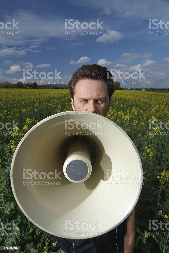 talking into megaphone royalty-free stock photo
