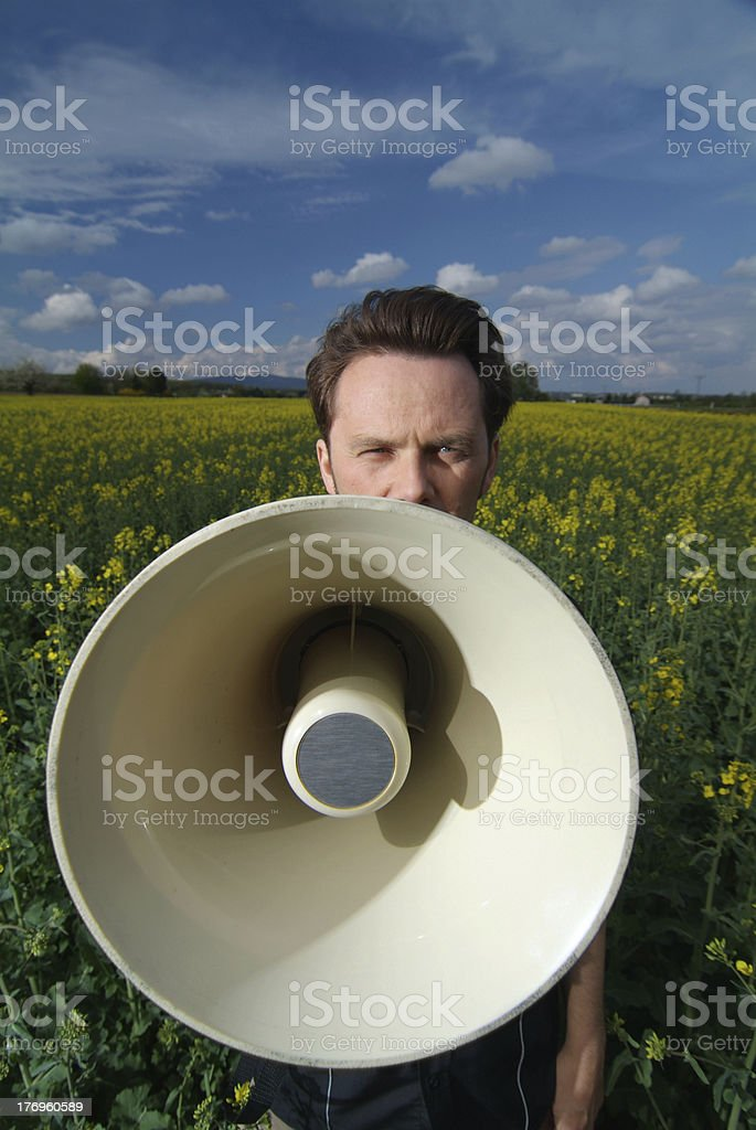 talking into megaphone stock photo