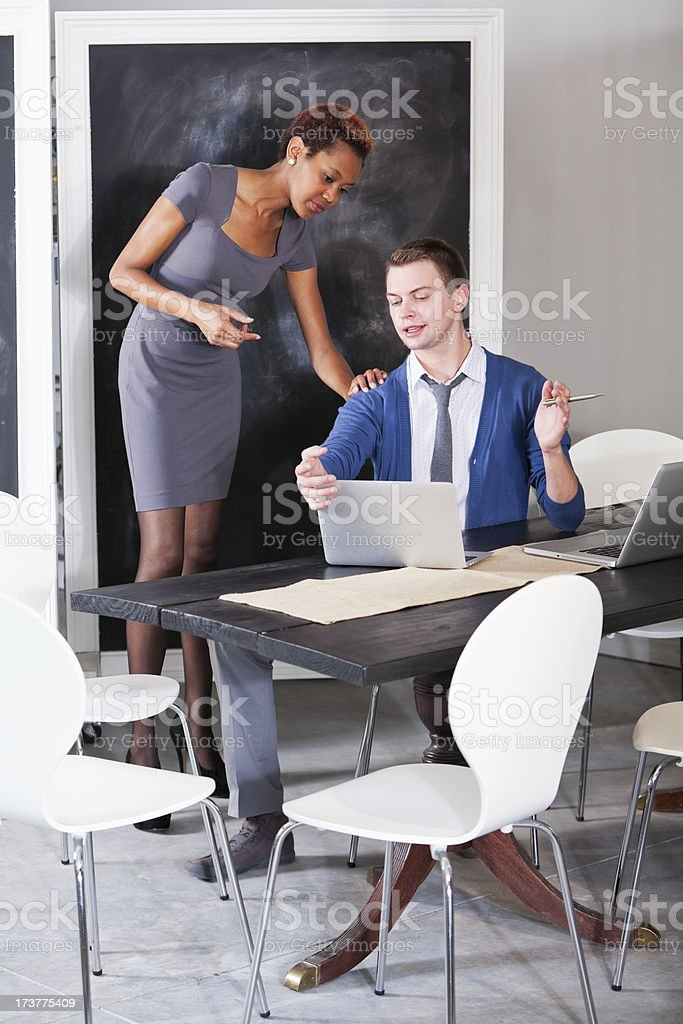 Talking, looking at laptop royalty-free stock photo