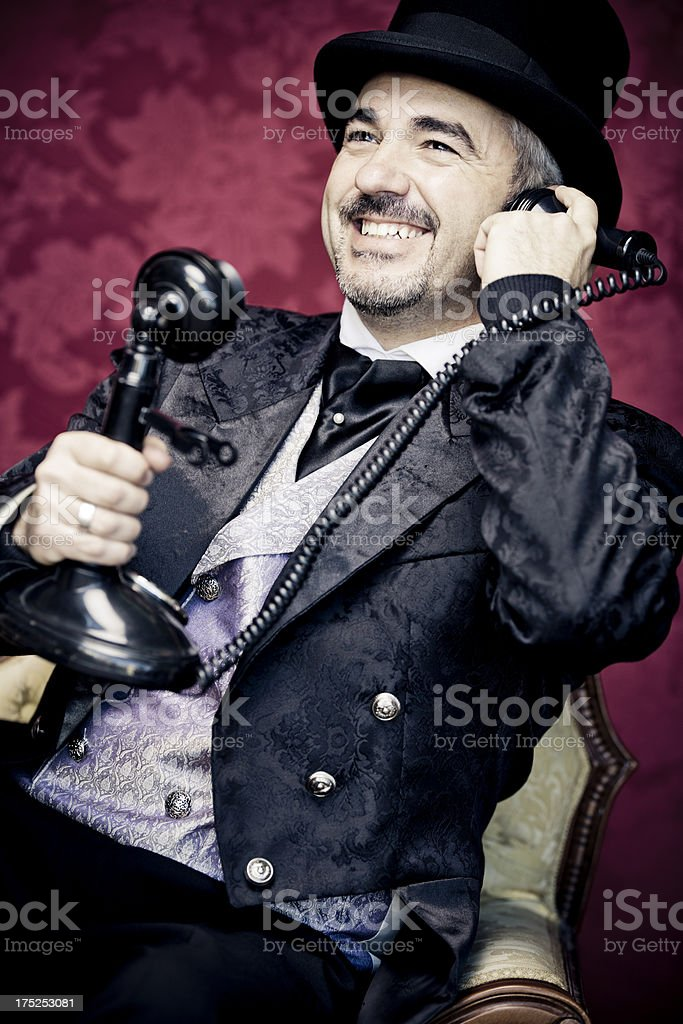 Talking on phone in vintage style royalty-free stock photo