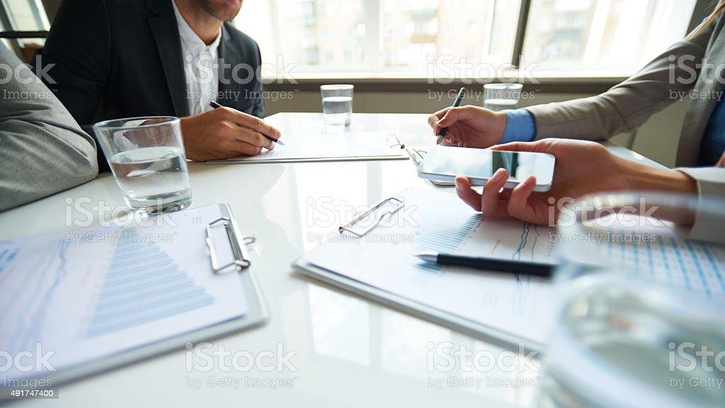 Talking on speaker phone stock photo