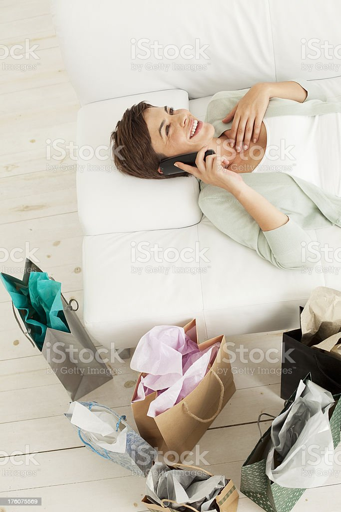 Talking on the phone after shopping. royalty-free stock photo