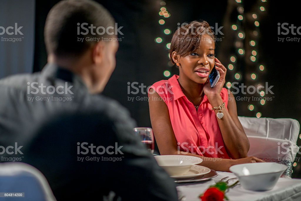 Talking on the Phone During a Date stock photo