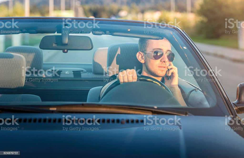 Talking on the phone while driving stock photo