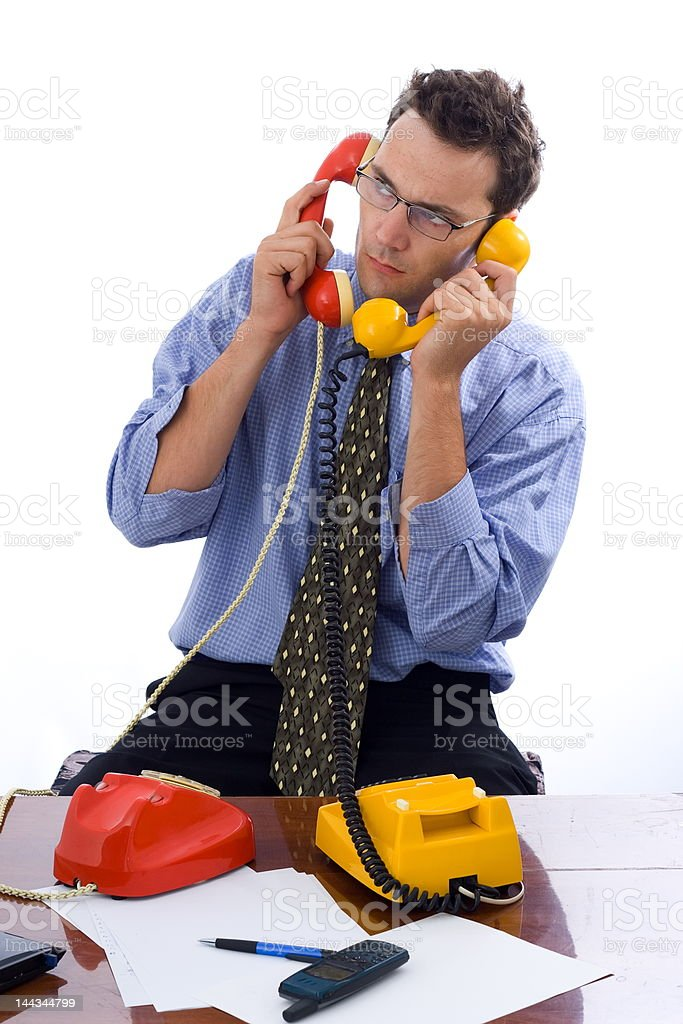 Talking on two telephones royalty-free stock photo