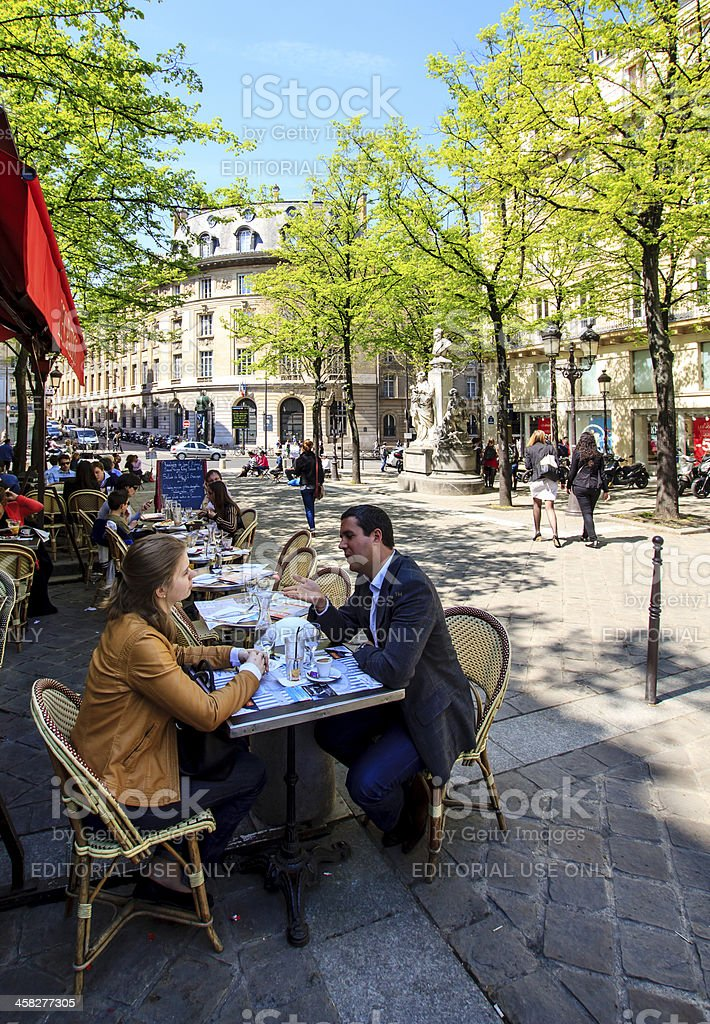 Talking over a coffee in Paris stock photo