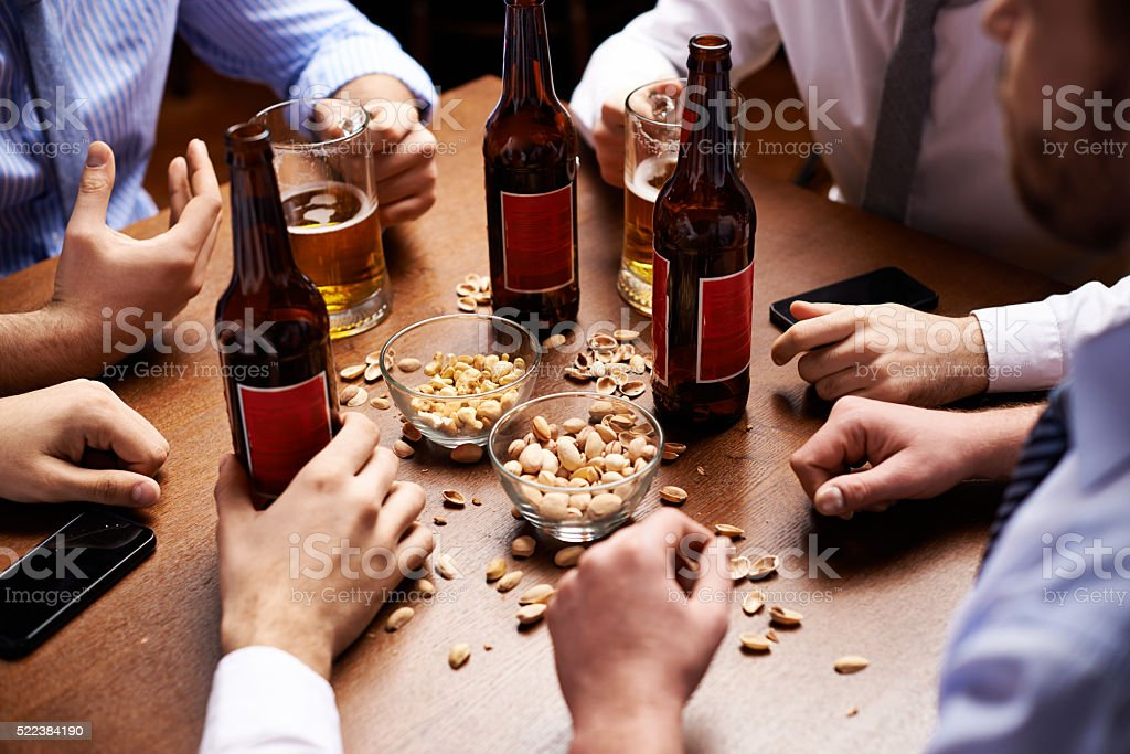 Talking over beer stock photo