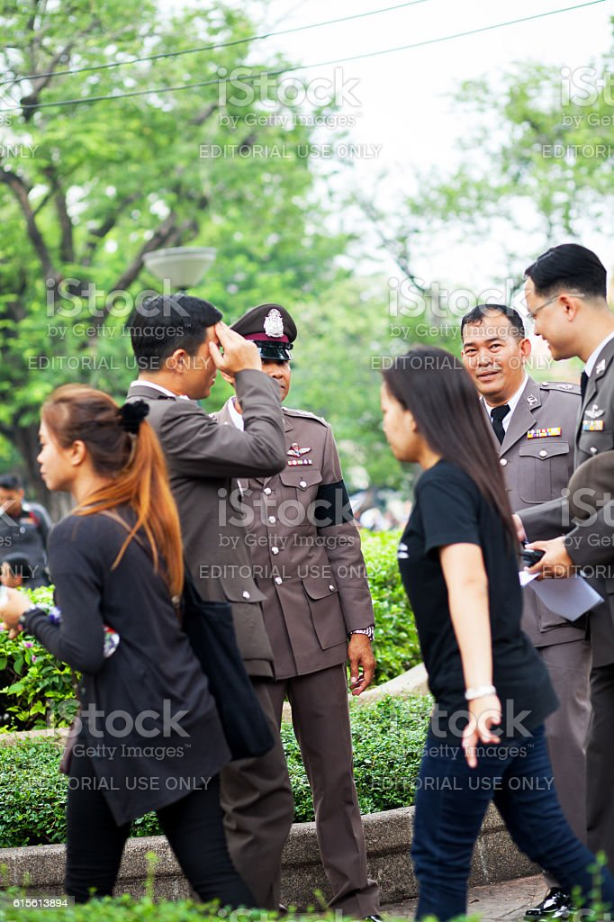 Talking police officers at condolence day for King Bhumipol stock photo