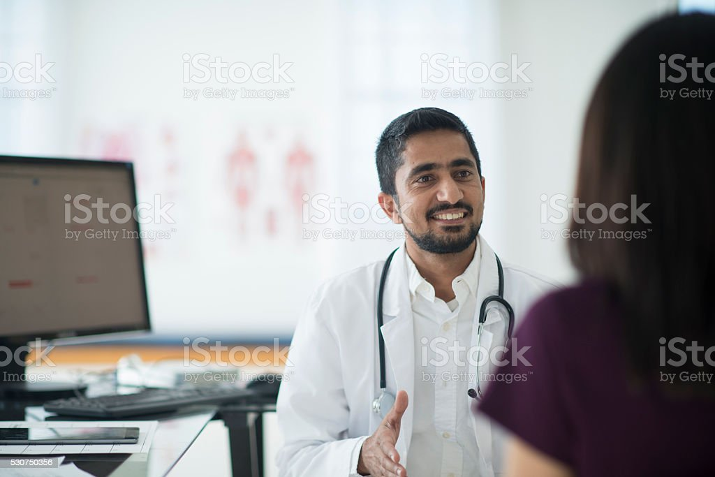 Talking to a Patient at the Office stock photo