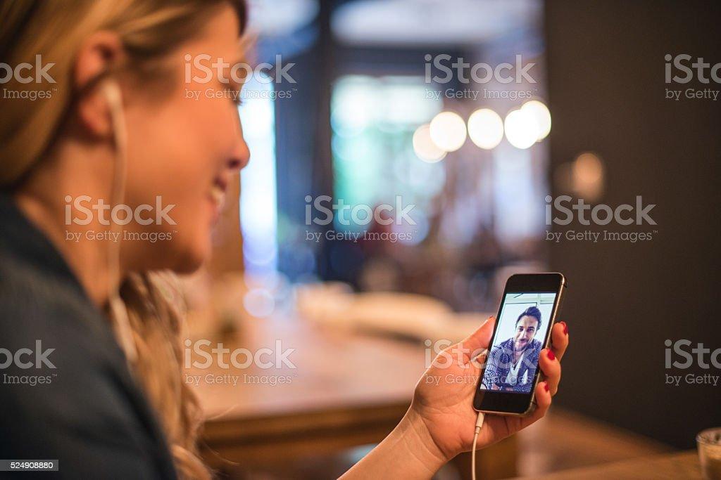 Talking to her boyfriend stock photo