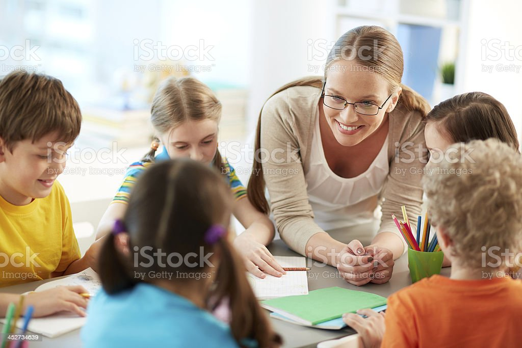 Talking to pupils stock photo