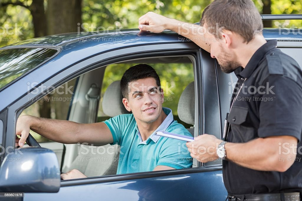 Talking with experienced policeman stock photo