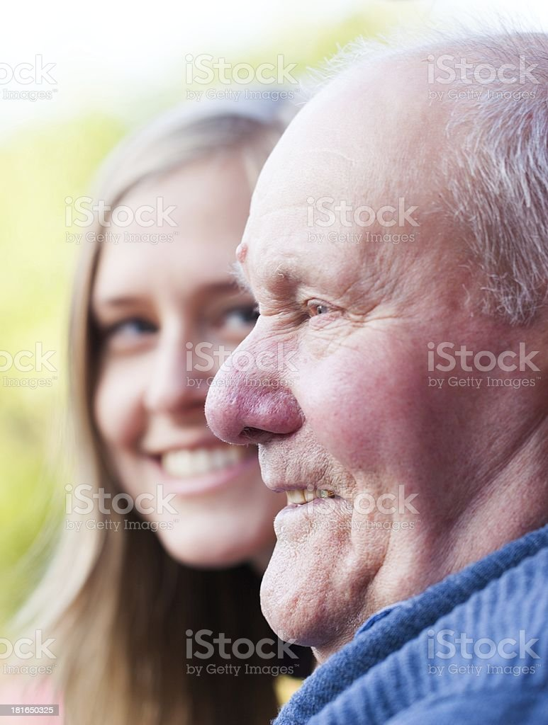 Talking with grandfather royalty-free stock photo