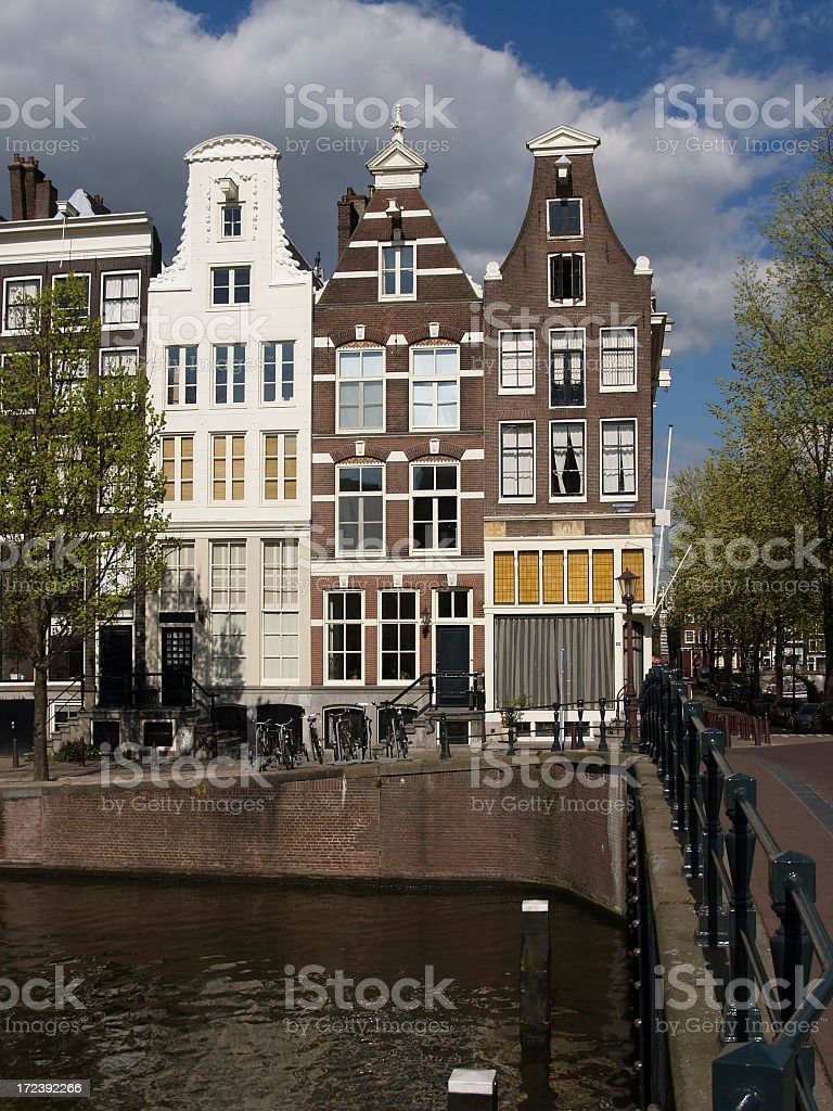 Tall Amsterdam Homes Along Canal royalty-free stock photo