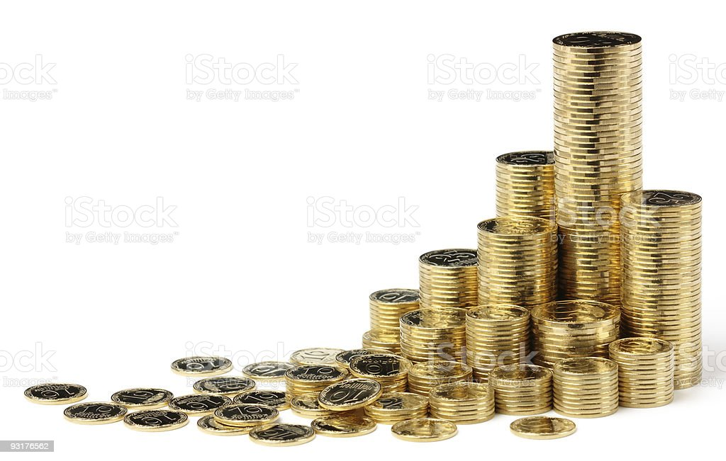 Tall and short stacks of golden coins over white background stock photo