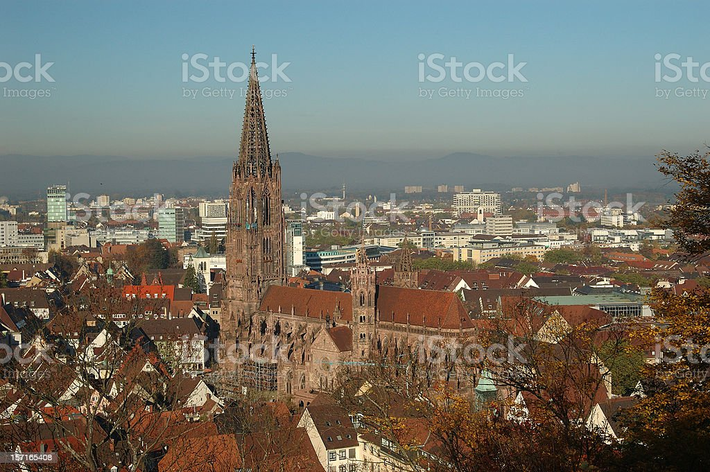 Tall, brown Freiburg Minster cathedral in Breisgau, Germany royalty-free stock photo