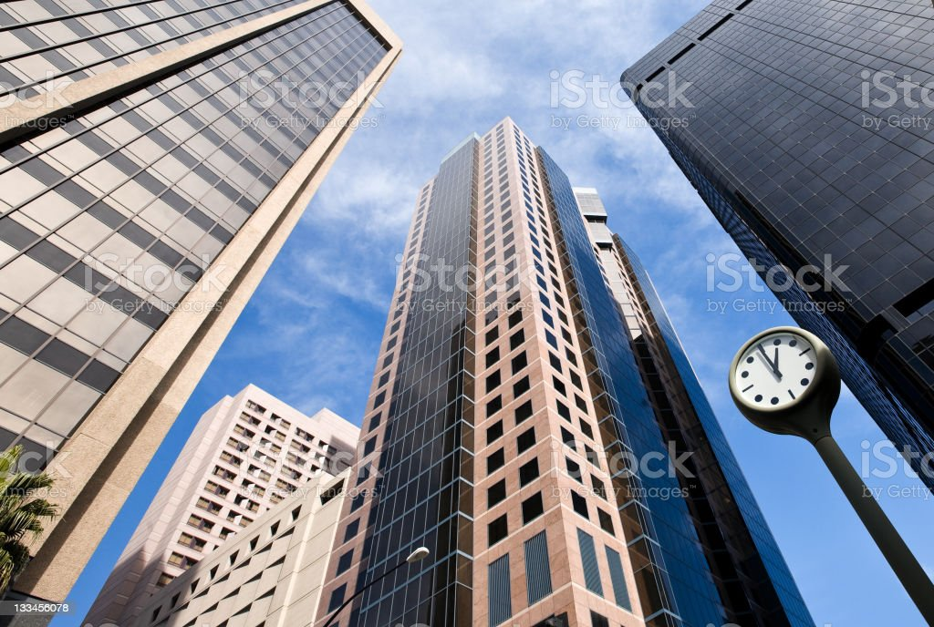 Tall buildings and clock in the financial district stock photo