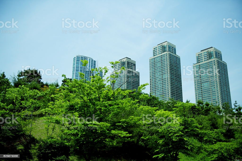 Tall buildings behind green area,korea,seoul stock photo