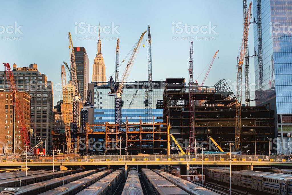 tall buildings under construction and cranes in New York City stock photo