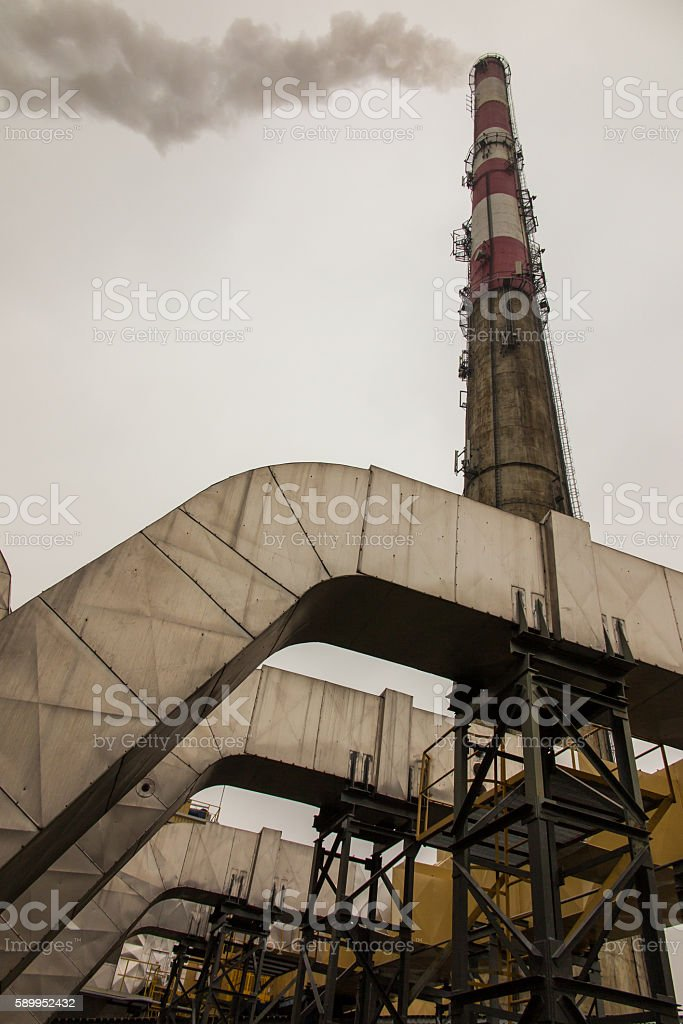 tall chimney with smoke stock photo