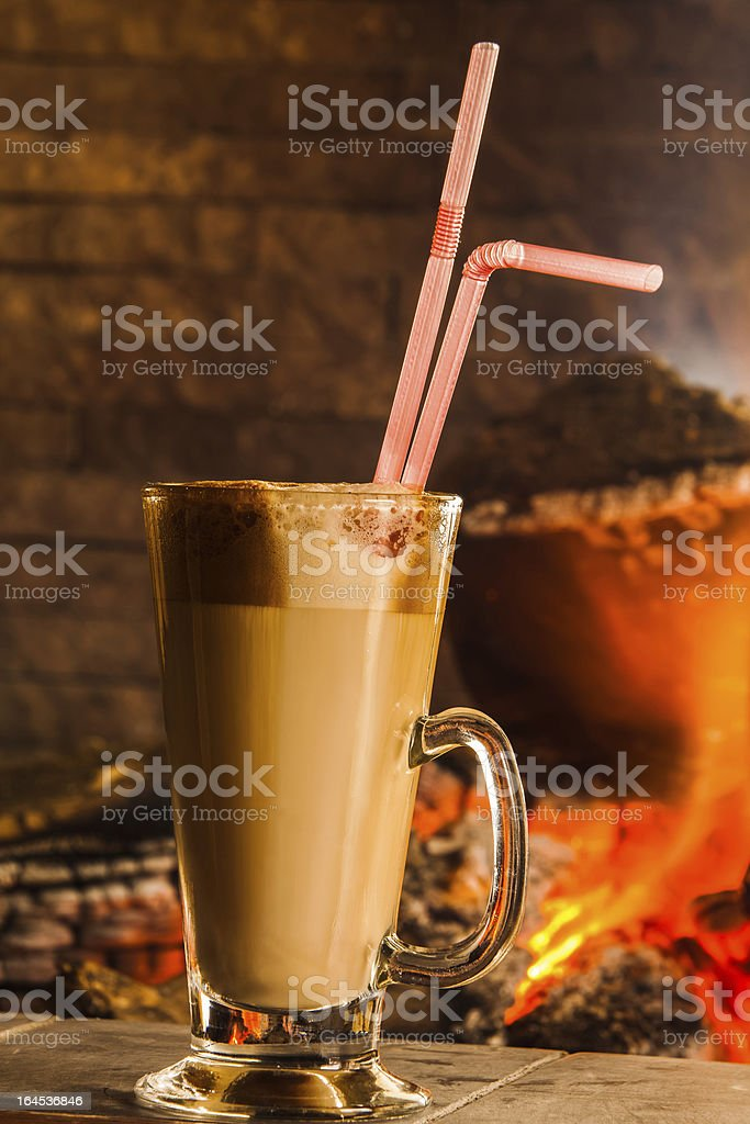 Tall cup of fresh coffee latte  with whipped cream stock photo