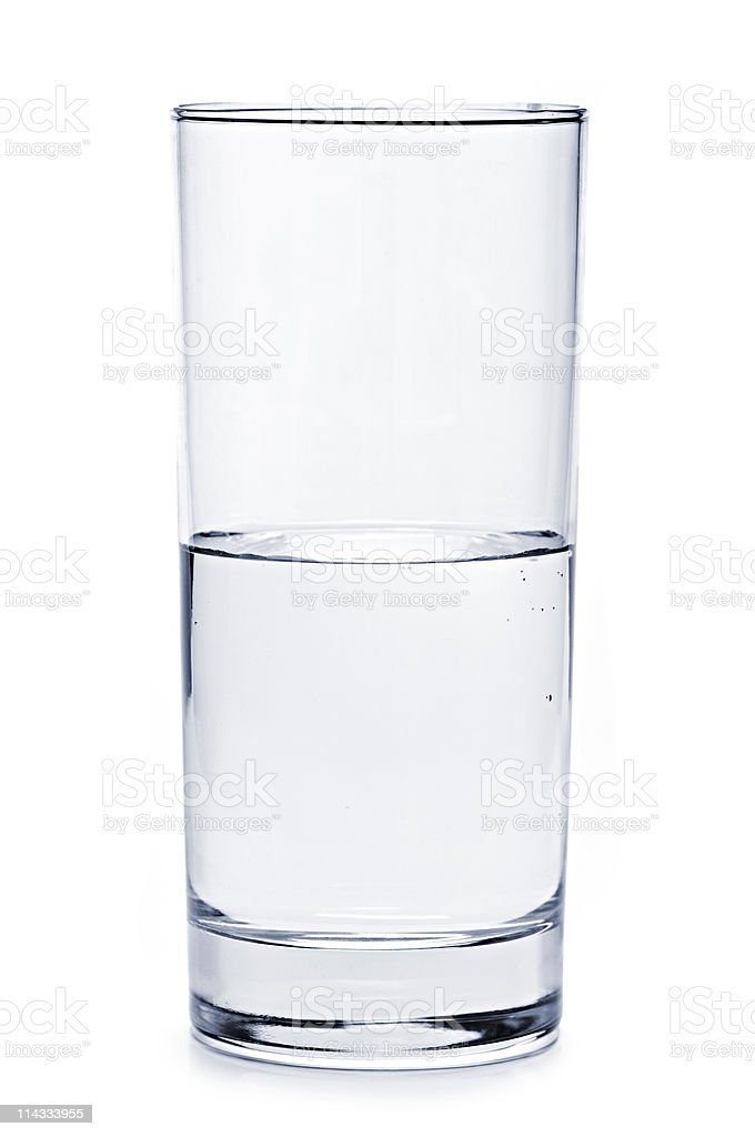 A tall glass half full with pure water stock photo